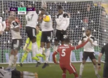 Fulham Player Lies Down Behind Wall